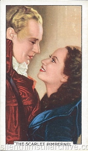 Leslie Howard and Merle Oberon in THE SCARLET PIMPERNEL (1934) Gallaher Ltd. Famous Film Scene card
