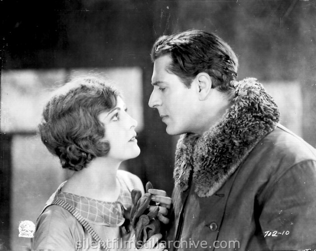 Billie Dove and Warner Baxter in THE AIR MAIL (1925)