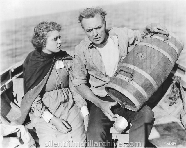 Jane Novak and Hobart Bosworth in a lifeboat from BEHIND THE DOOR (1919)