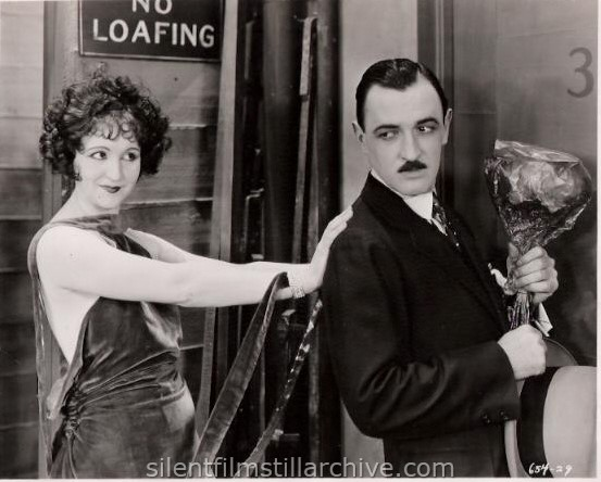 Julia Faye and Raymond Griffith in CHANGING HUSBANDS (1924)