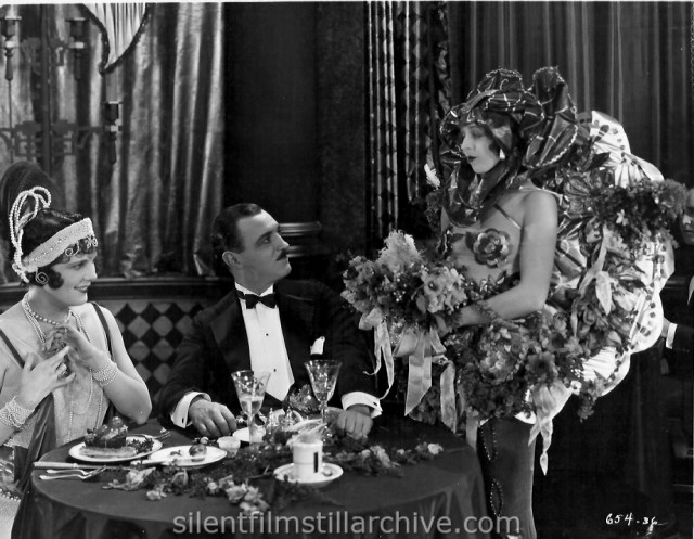 Leatrice Joy and Raymond Griffith in CHANGING HUSBANDS (1924)