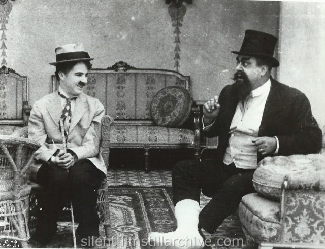 Charlie Chaplin and Eric Campbell in THE CURE (1917).