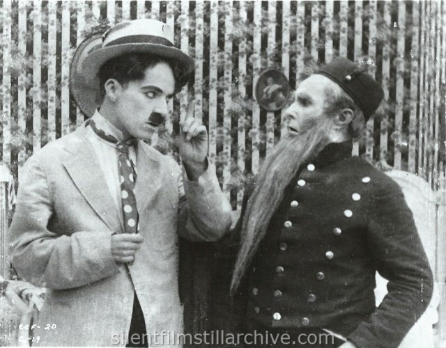 Charlie Chaplin and James T. Kelly in THE CURE (1917).