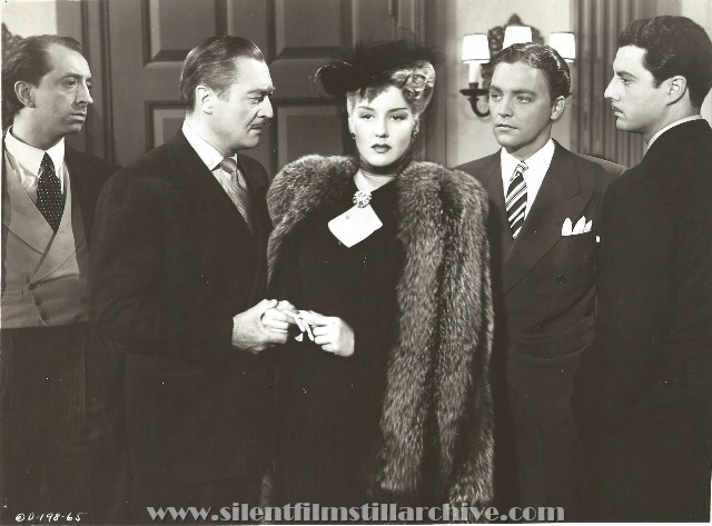 John Abbott, Edmund Lowe, Ann Savage, John Hubbard, and Stanley Brown in DANGEROUS BLONDES (1943).