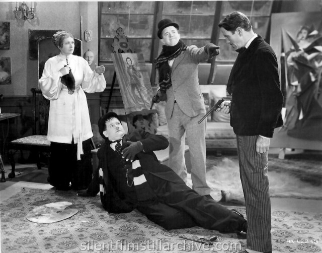 Stan Laurel and Oliver Hardy in THE FIXER UPPERS (1935)