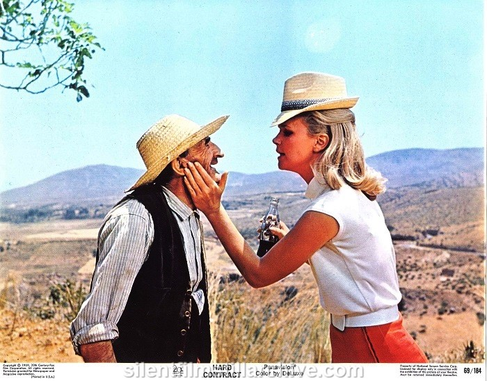 Lobby card with Lee Remick in HARD CONTRACT (1969)