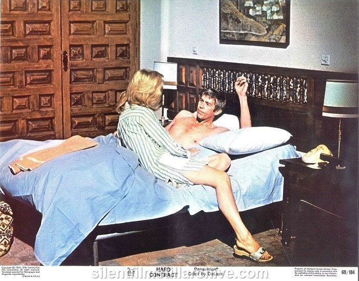 Lobby card with Lee Remick and James Coburn in HARD CONTRACT (1969)