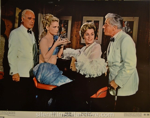 Lobby card with Patrick Mcgee, Lee Remick and Helen Cherry in HARD CONTRACT (1969)