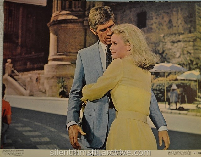 Lobby card with James Coburn and Lee Remick in HARD CONTRACT (1969)