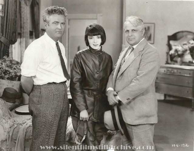 Director Marshall Neilan, actress Colleen Moore and Labor Secretary James J. Davis on the set of HER WILD OAT (1927).