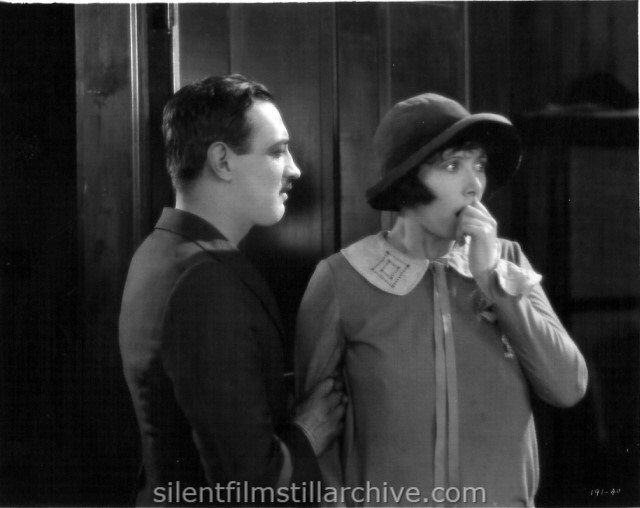 Raymond Griffith and Mae Busch in NELLIE THE BEAUTIFUL CLOAK MODEL (1924)