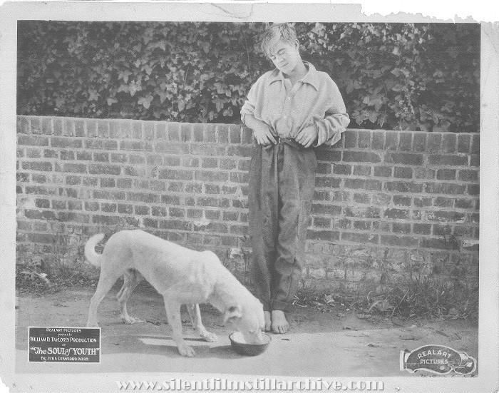 Lobby card for THE SOUL OF YOUTH (1920) with Lewis Sargent and dog