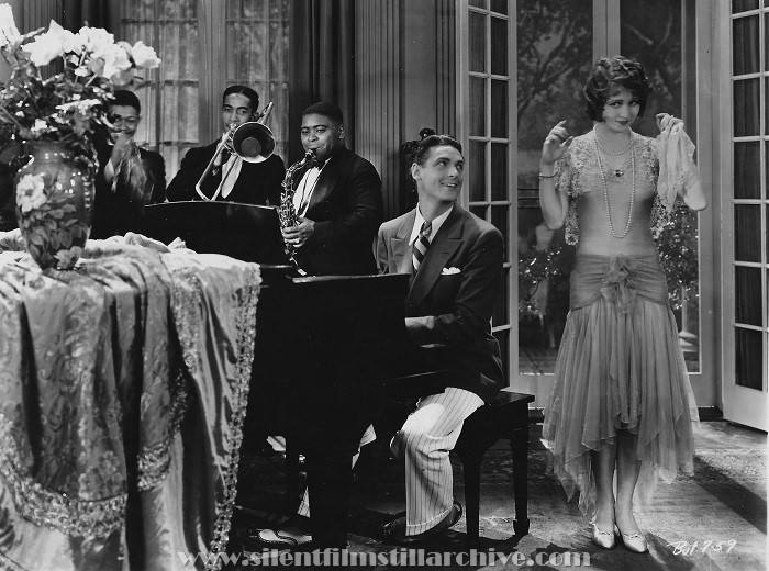 George Orendorff (trumpet), Lawrence Brown (trombone), Paul Howard (saxophone), Charles Farrell and Sharon Lynn in SUNNY SIDE UP (1929). The musicians are members of the band Paul Howard's Quality Serenaders.