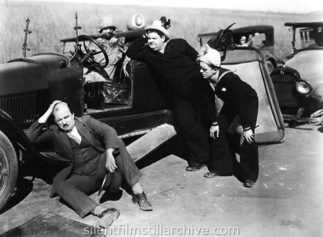 Edgar Kennedy, Oliver Hardy, and Stan Laurel in TWO TARS (1928).