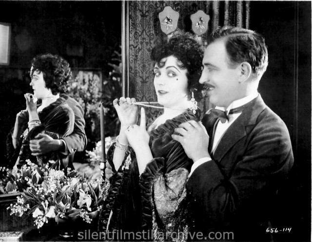Pola Negri and Raymond Griffith in LILY OF THE DUST (1924)